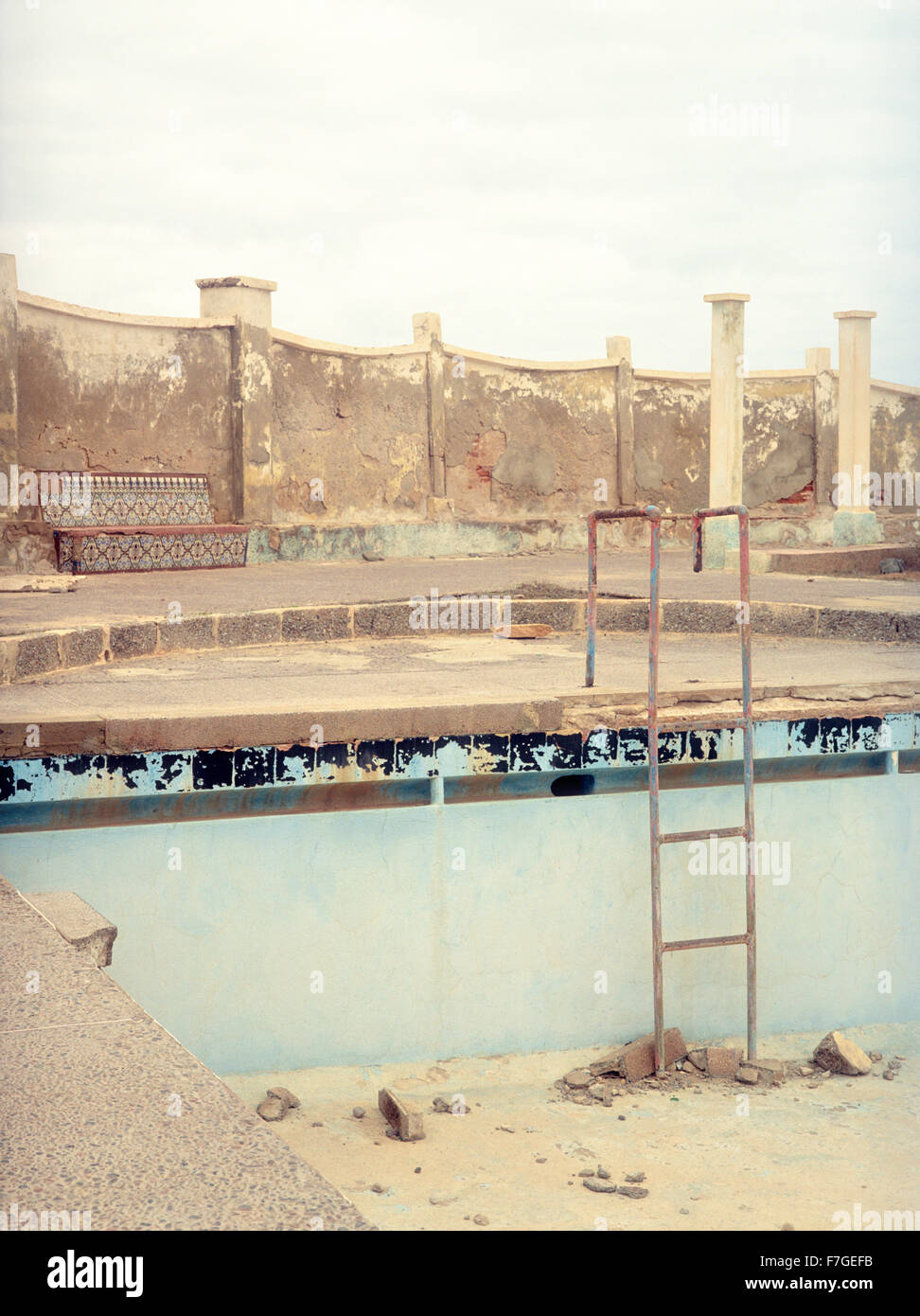 An abandoned and decaying swimming pool in Sidi Ifni ia former Spanish colony on the West coast of Morocco, North - Stock Image