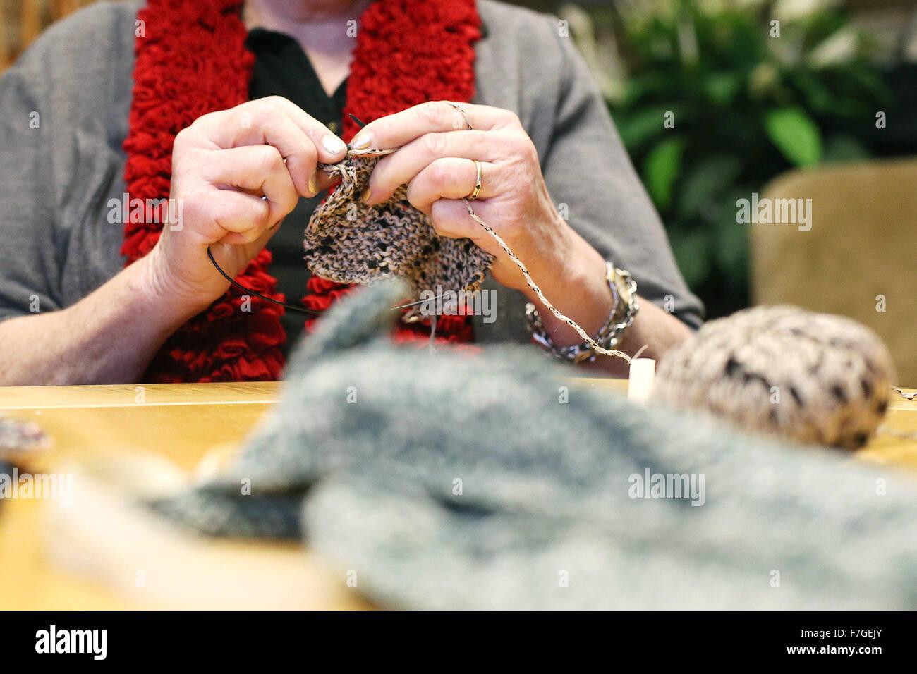 Napa, CA, USA. 28th Nov, 2015. Susan Blake knits in the club house at The Reserve in Napa on Saturday. Blake, and - Stock Image
