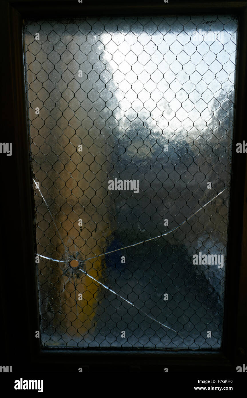 Bullet hole in window of the autopsy room of the former Vancouver morgue, Vancouver Police Museum, Vancouver, BC, - Stock Image