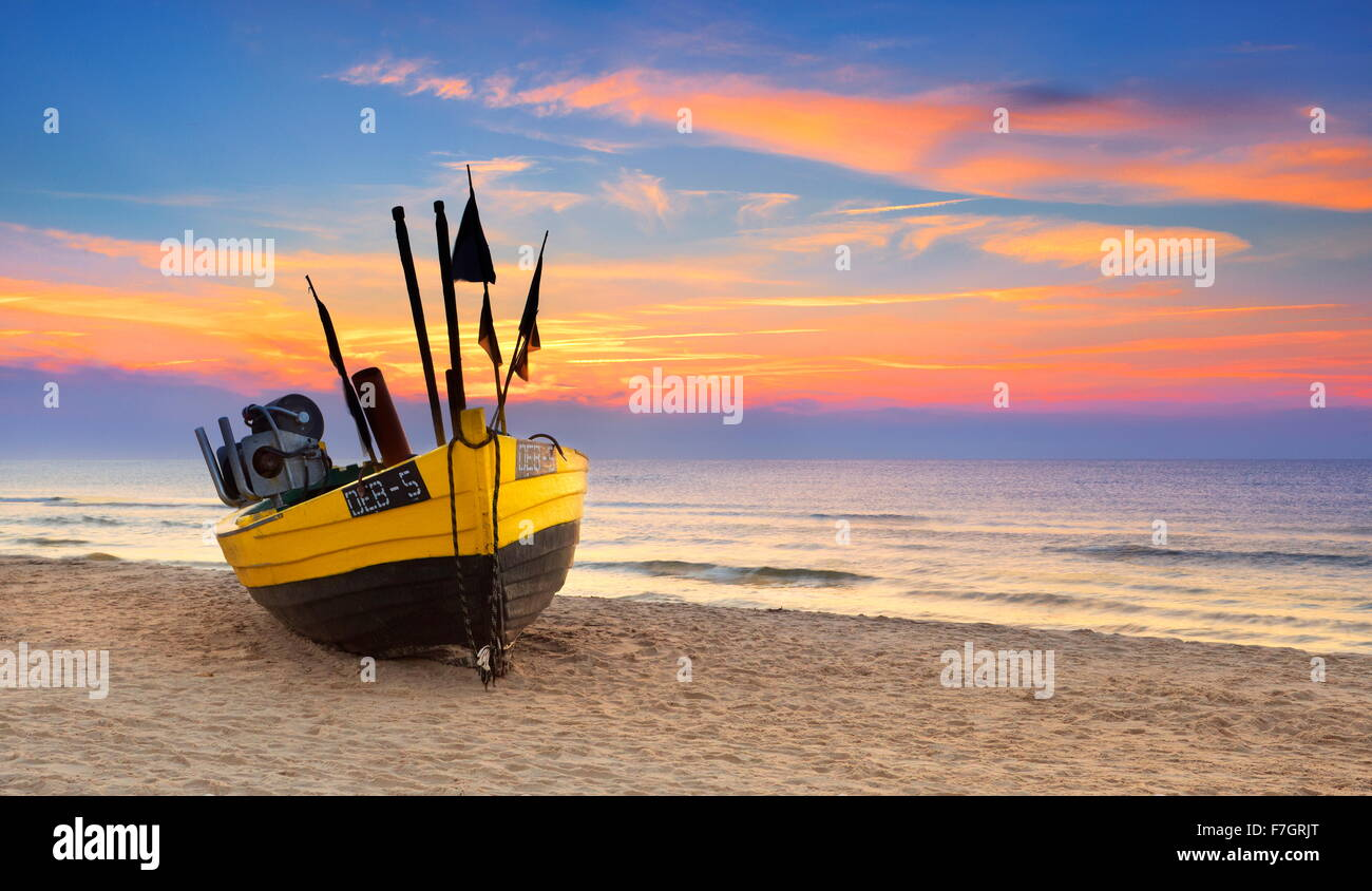Fishing boat at Baltic Sea, sunset time, Pomerania, Poland - Stock Image