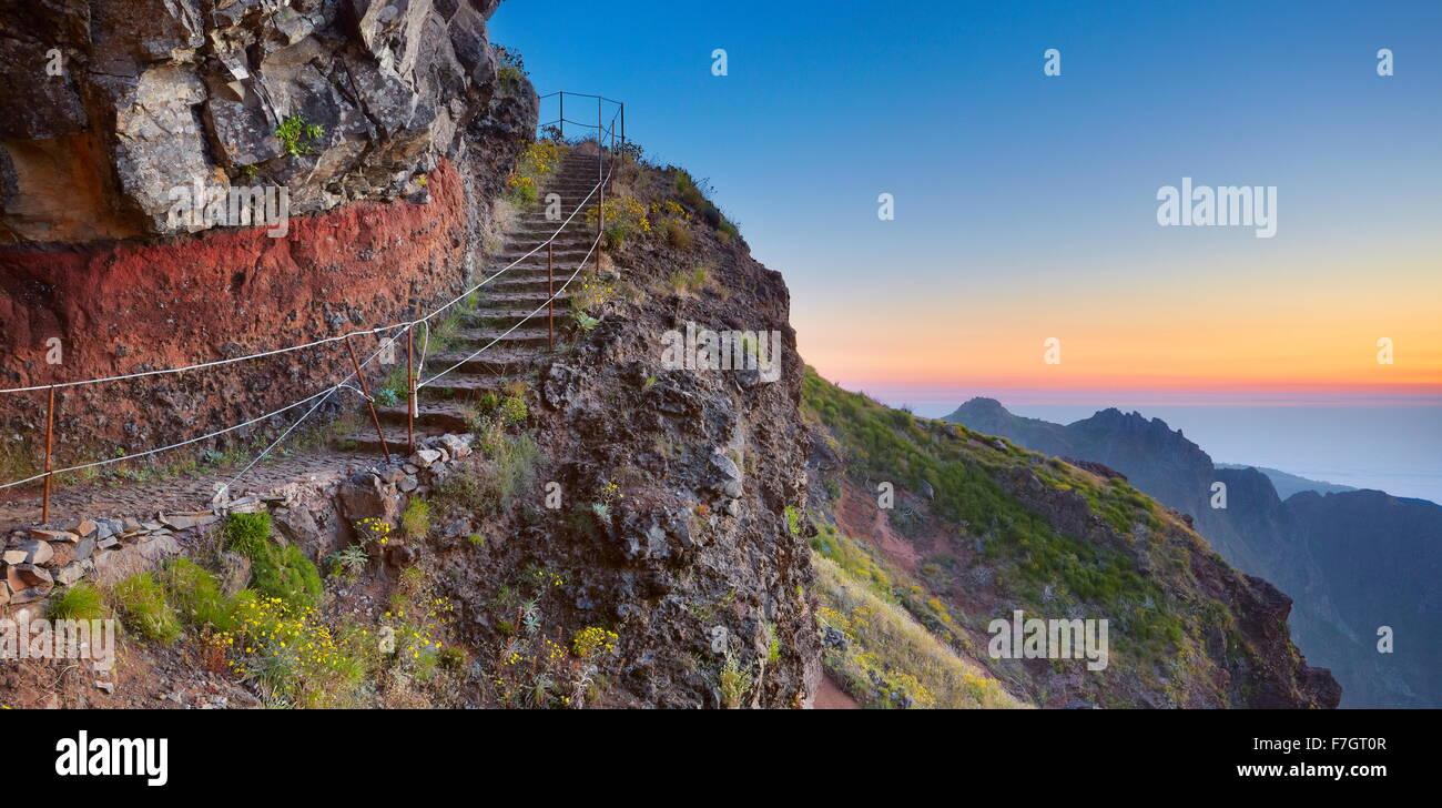 Mountain hiking trail from  Pico do Arieiro to Pico Ruivo before sunrise, Madeira Island, Portugal - Stock Image