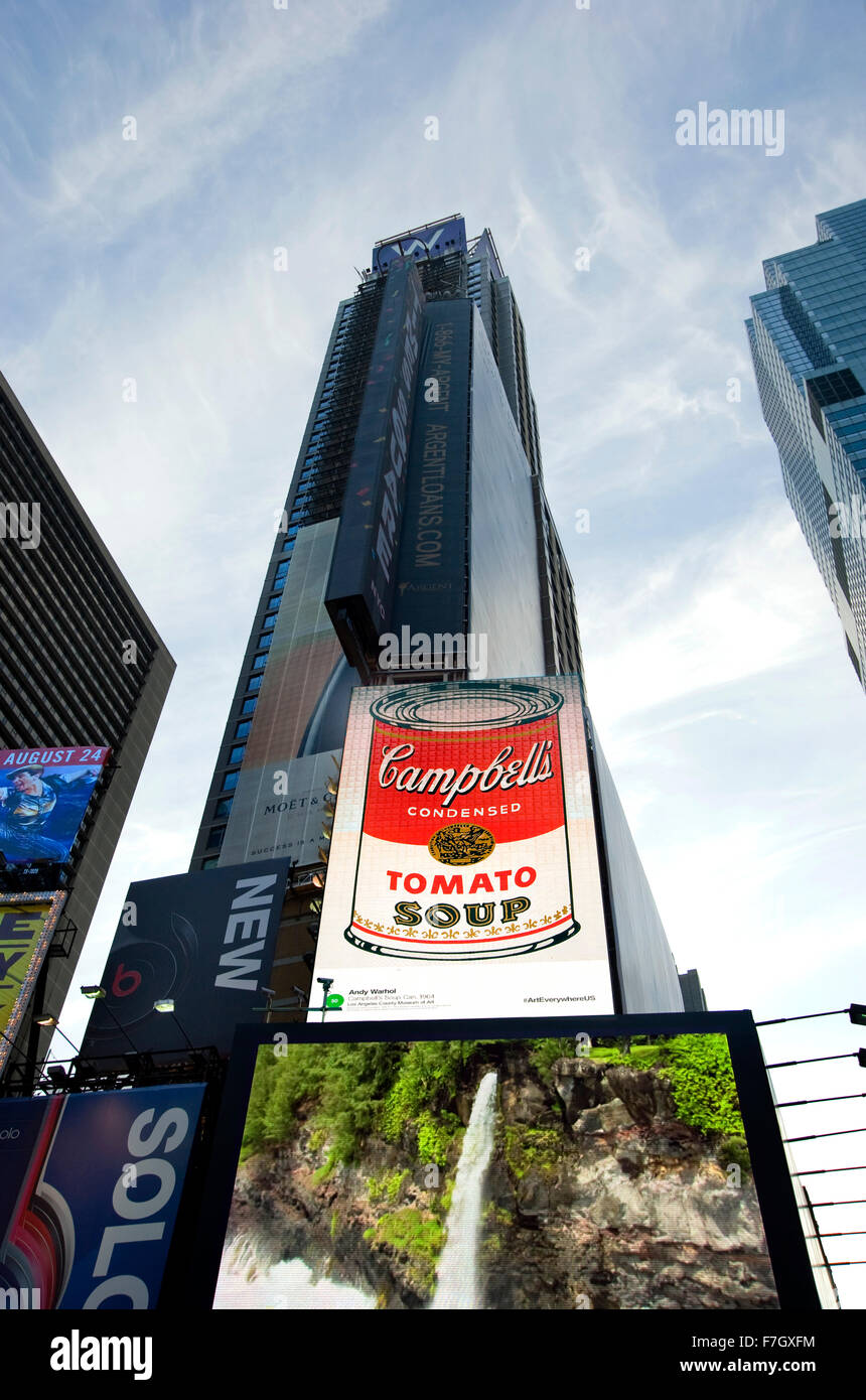 Fine art images like Andy Warhol's Campbell's soup painting appears on commercial billboards in Times Square, - Stock Image
