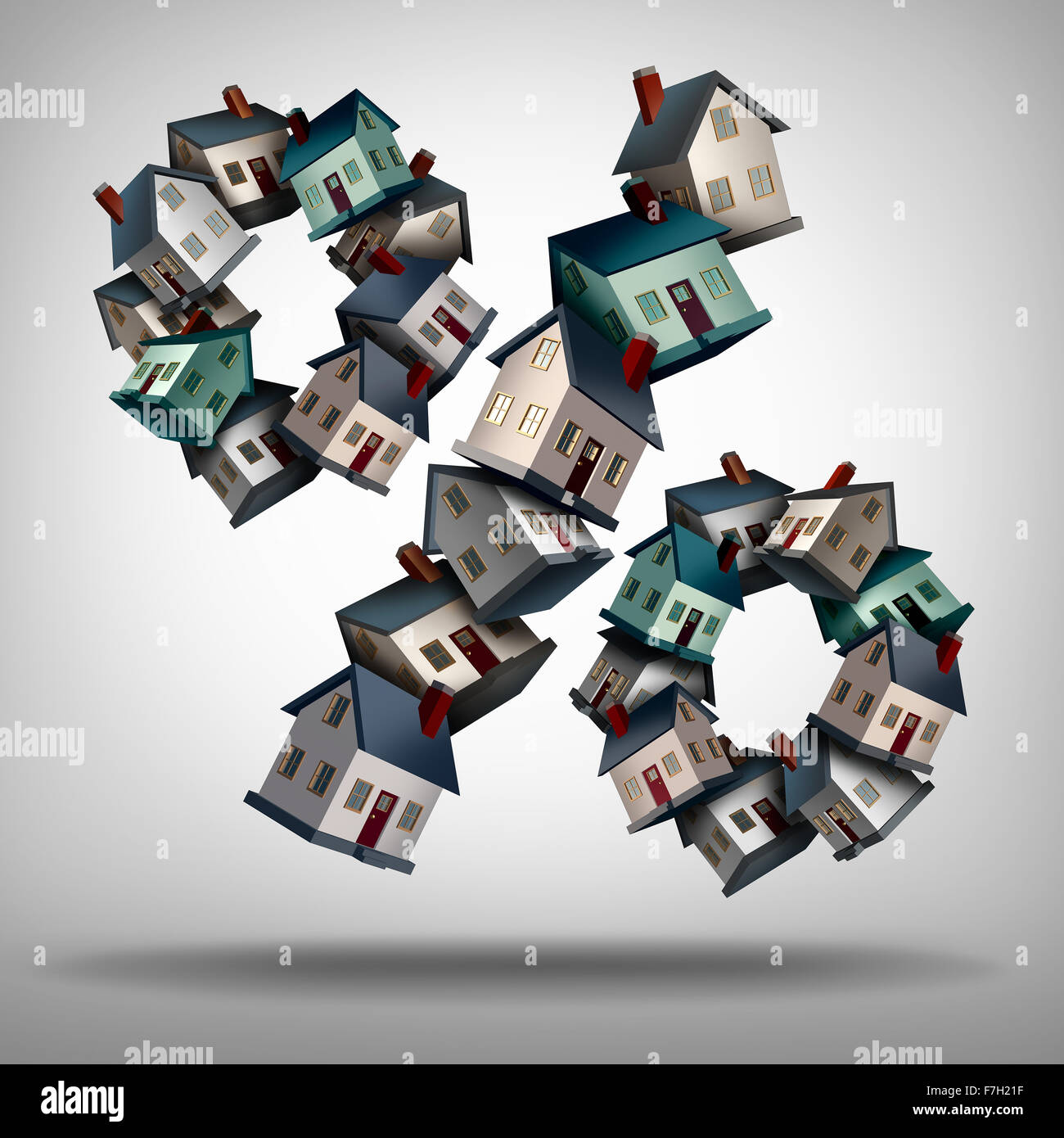 Home mortgage rates concept and interest rate symbol as a group of homes or houses shaped as a percentage sign for - Stock Image