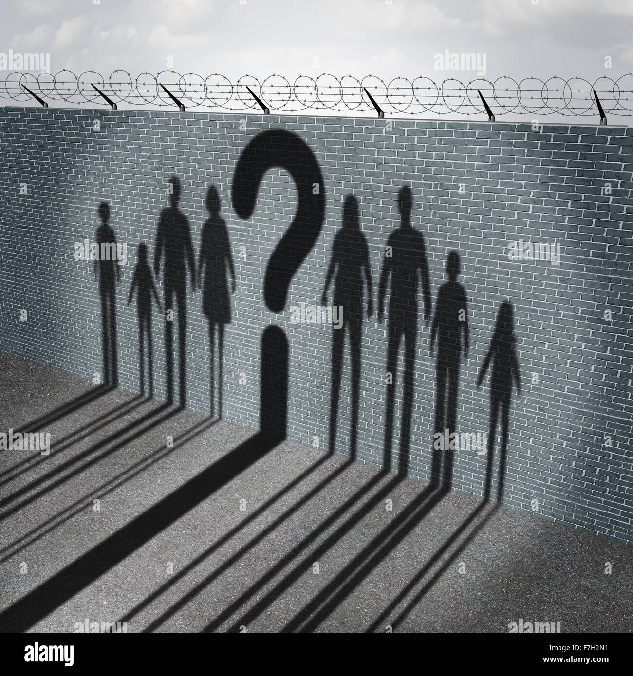 Immigration crisis as foreign people on a border wall for a social issue about refugees or illegal immigrants with - Stock Image
