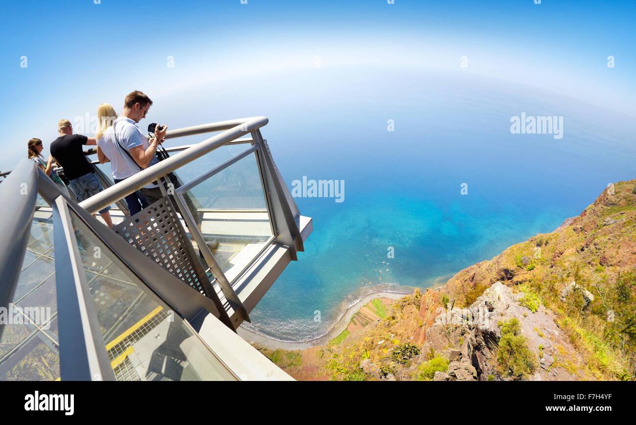 Tourist on the panoramic terrace at the top of Cabo Girao (580 m highest) cliff - Camara de Lobos, Madeira Island, - Stock Image