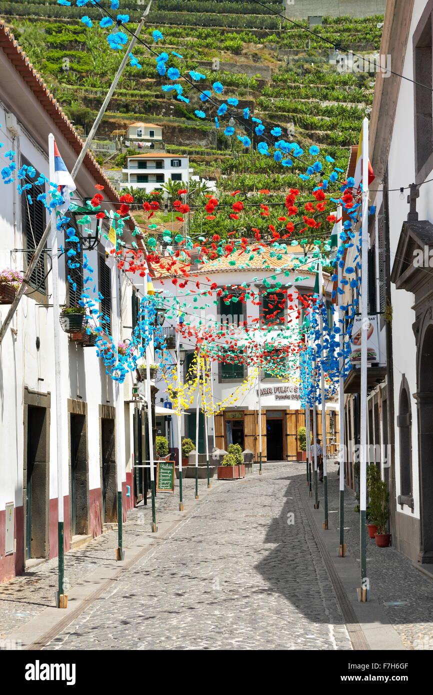 Street decorated with paper flowers on feast of Madeira Island, Camara de Lobos, Madeira, Portugal - Stock Image