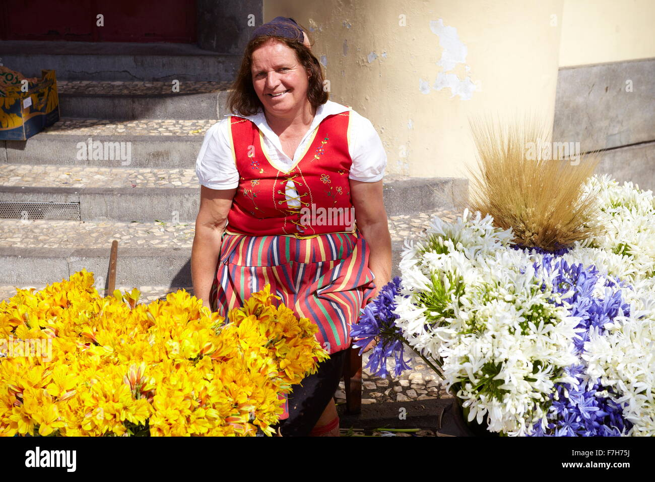 Flowers seller in Funchal market, Madeira, Portugal - Stock Image