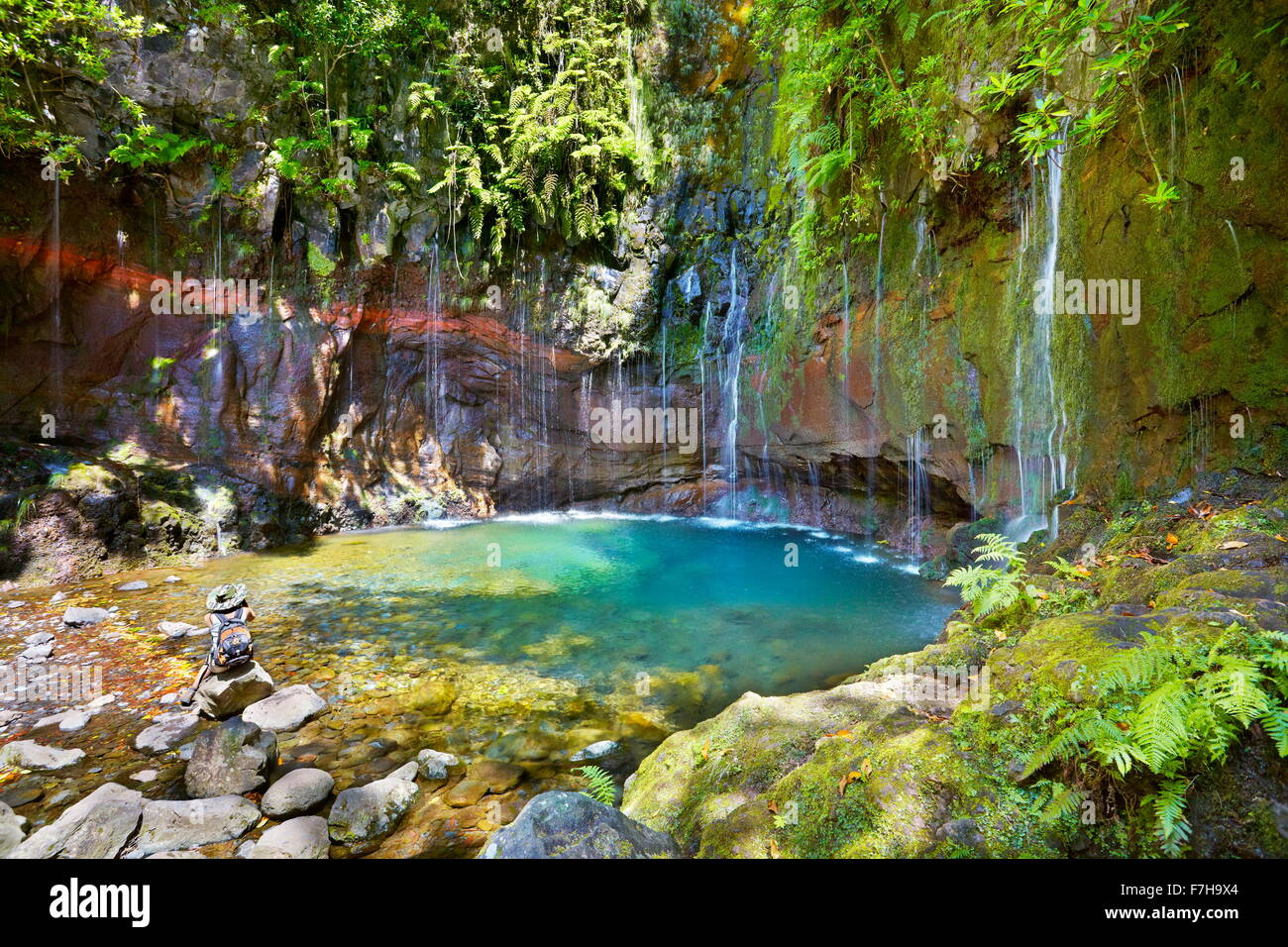 Tourist resting at the Levada 25 fountains, Rabacal, Madeira Island, Portugal - Stock Image