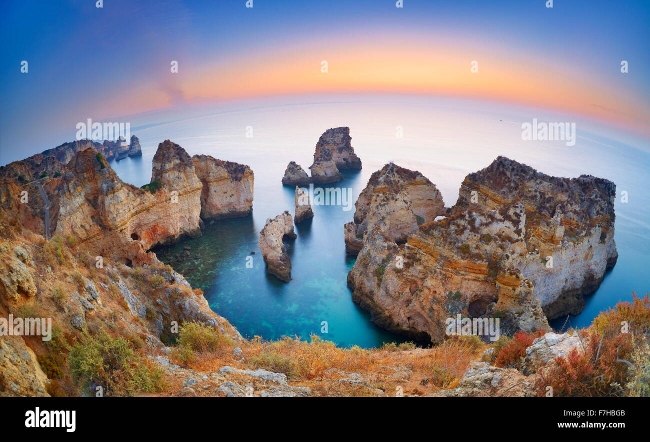 Algarve coast before sunrise, Ponta da Piedade, Algarve, Lagos, Portugal - Stock Image