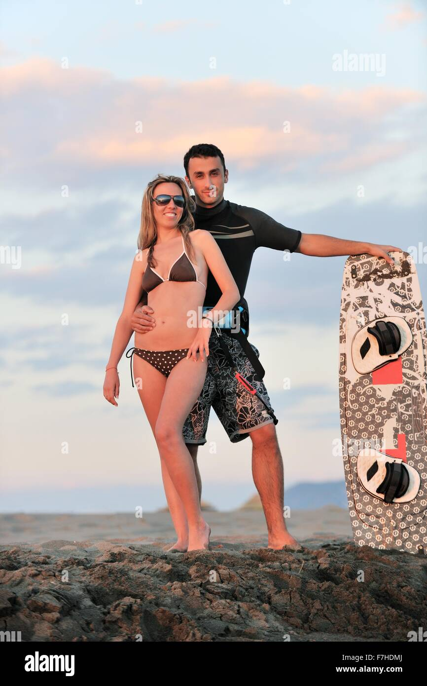 Romantic Couple In Surf Wear Posing At Beach On Sunset At Summer Stock Photo Alamy