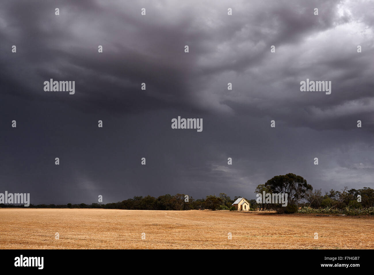 Summer storm moves over harvested cereal crop. Stock Photo