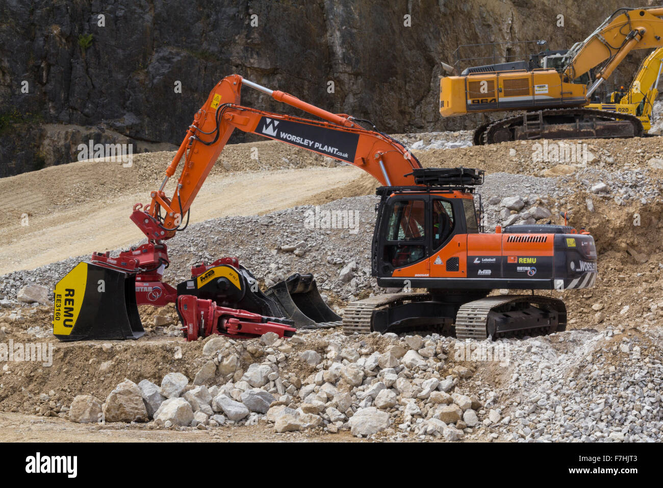 Demonstration of excavators with a selection of attachments  at Hillhead Quarrying Recycling and Construction Exhibition Stock Photo