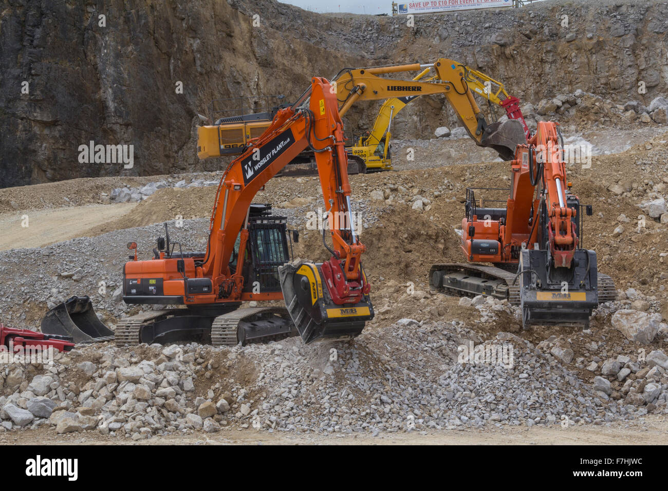 Demonstration of excavators at Hillhead Quarrying Recycling and Construction Exhibition - Stock Image