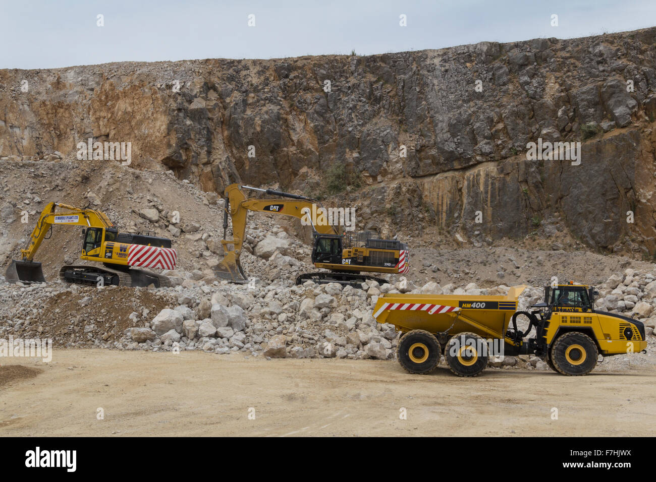 Demonstration of excavators and dump trucks at Hillhead Quarrying Recycling and Construction Exhibition Stock Photo