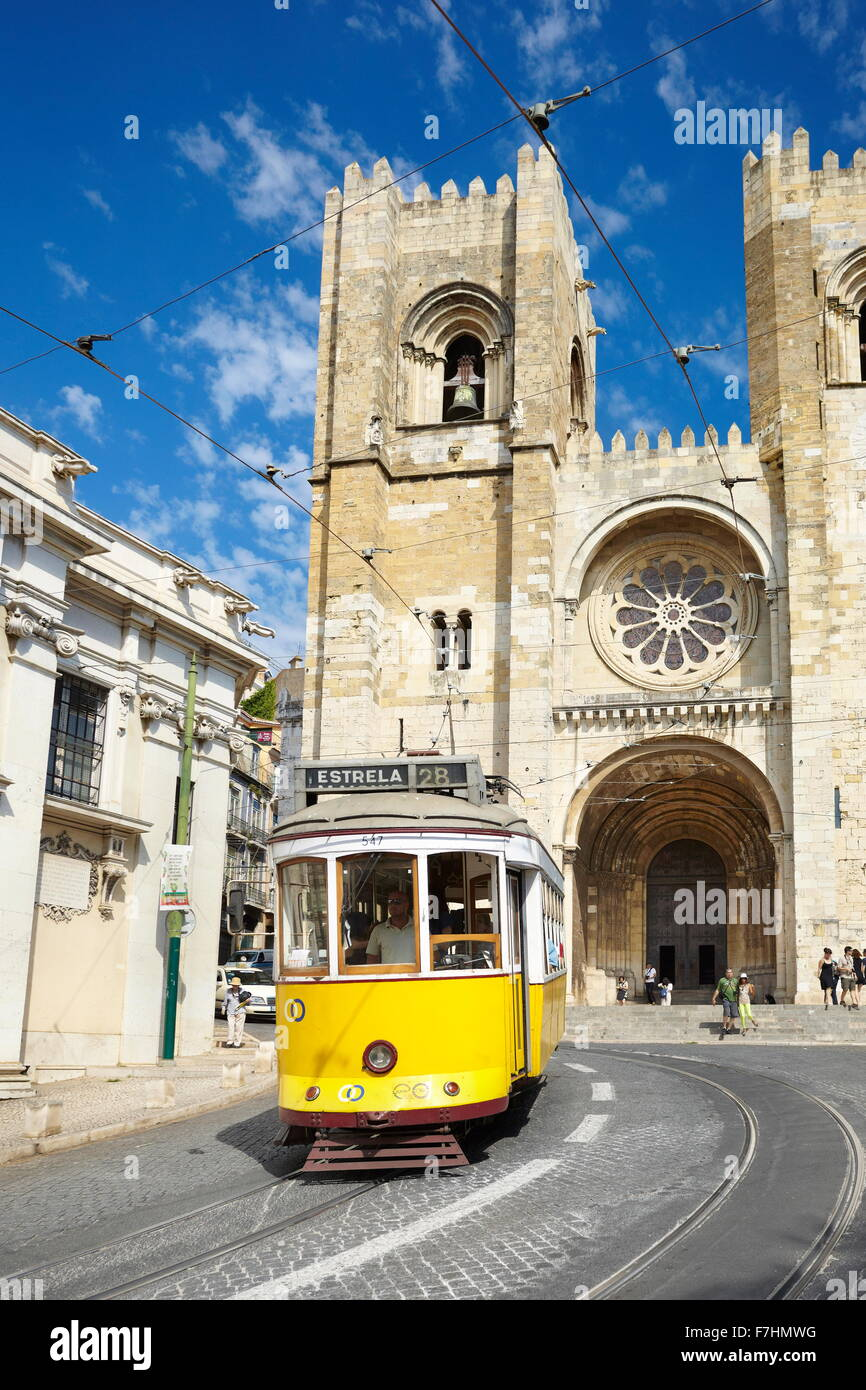 Tram 28, most famous line tram and Sé Cathedral, Alfama district, Lisbon, Portugal - Stock Image