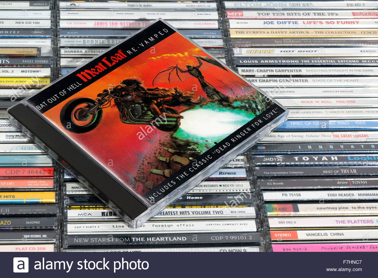 Meat Loaf Album Bat at of hell, piled music CD cases, England. - Stock Image