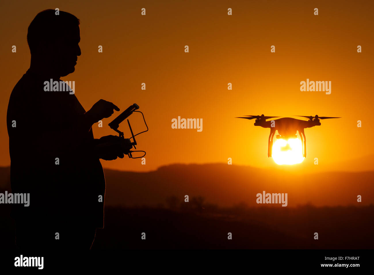 Driving a drone at sunset. Corella (Navarra) Spain - Stock Image