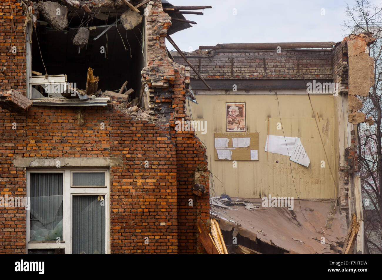 one of the last walls of a demolished school building with posters - Stock Image