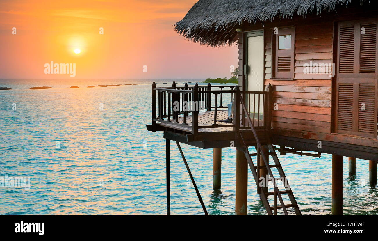 Tropical sunset landscape at Maldives Island, Indian Ocean - Stock Image