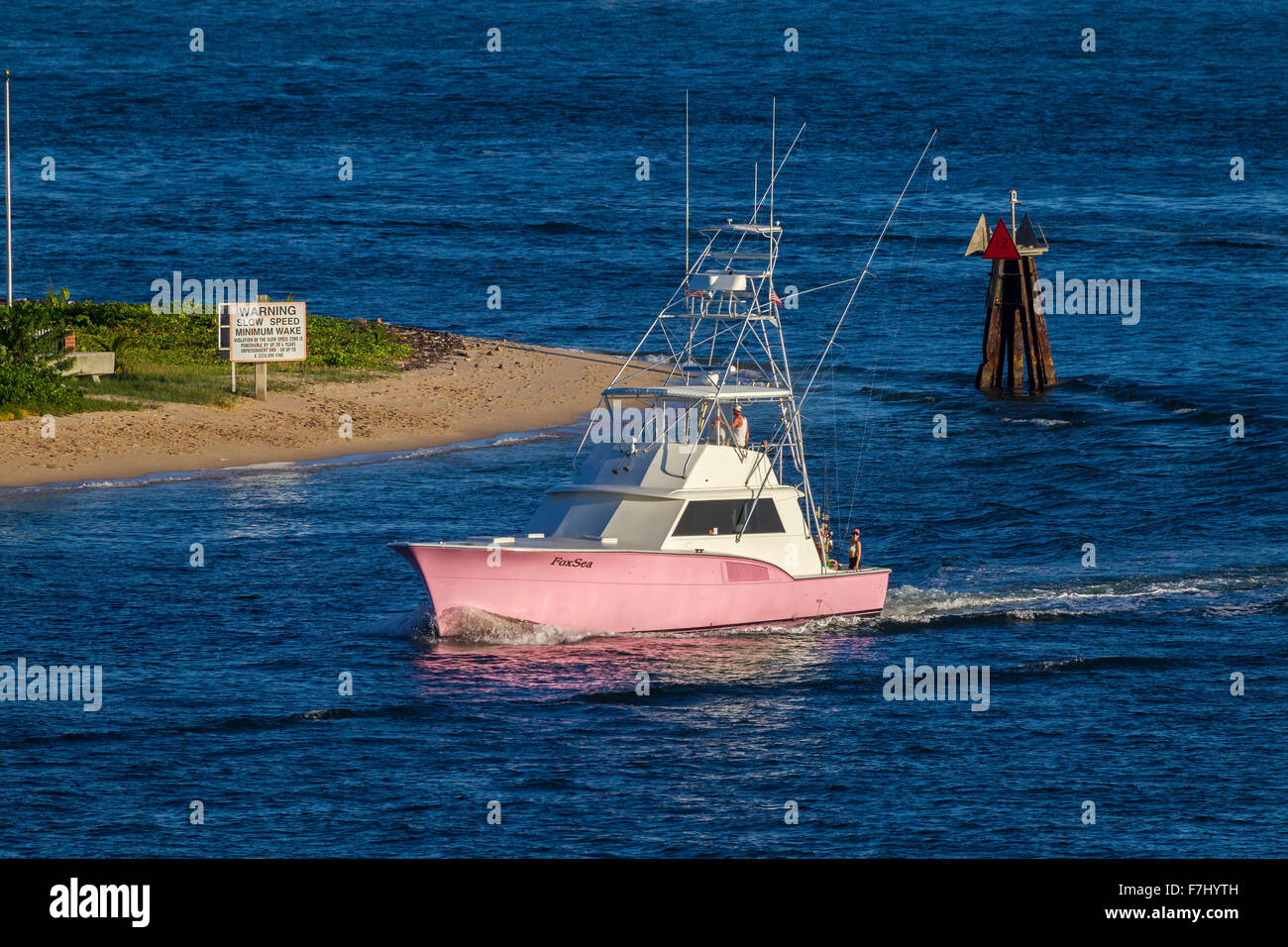 Pink fishing boat entering Port Everglades, Fort Lauderdale, Florida, U.S.A. Stock Photo