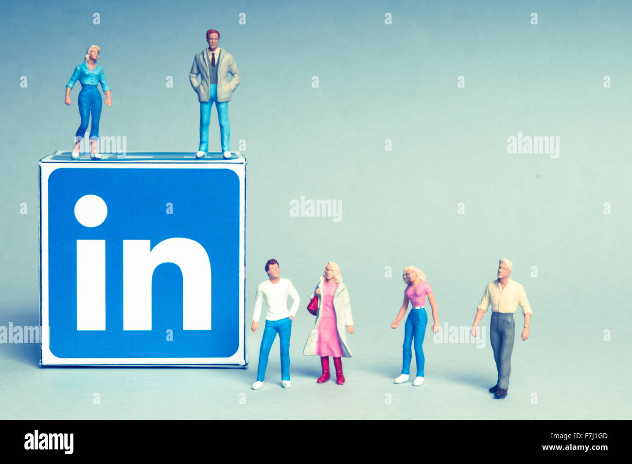 Linkedin logo and people figurines, social media, social relationships and social interactions concept - Stock Image