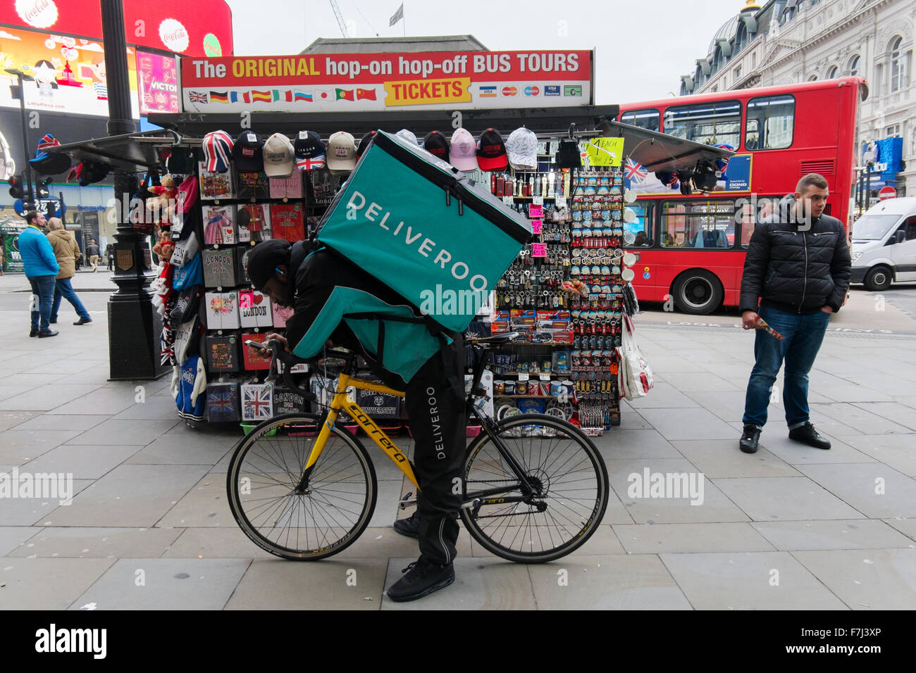 Black Man With A Deliveroo Takeaway Courier Bag On His