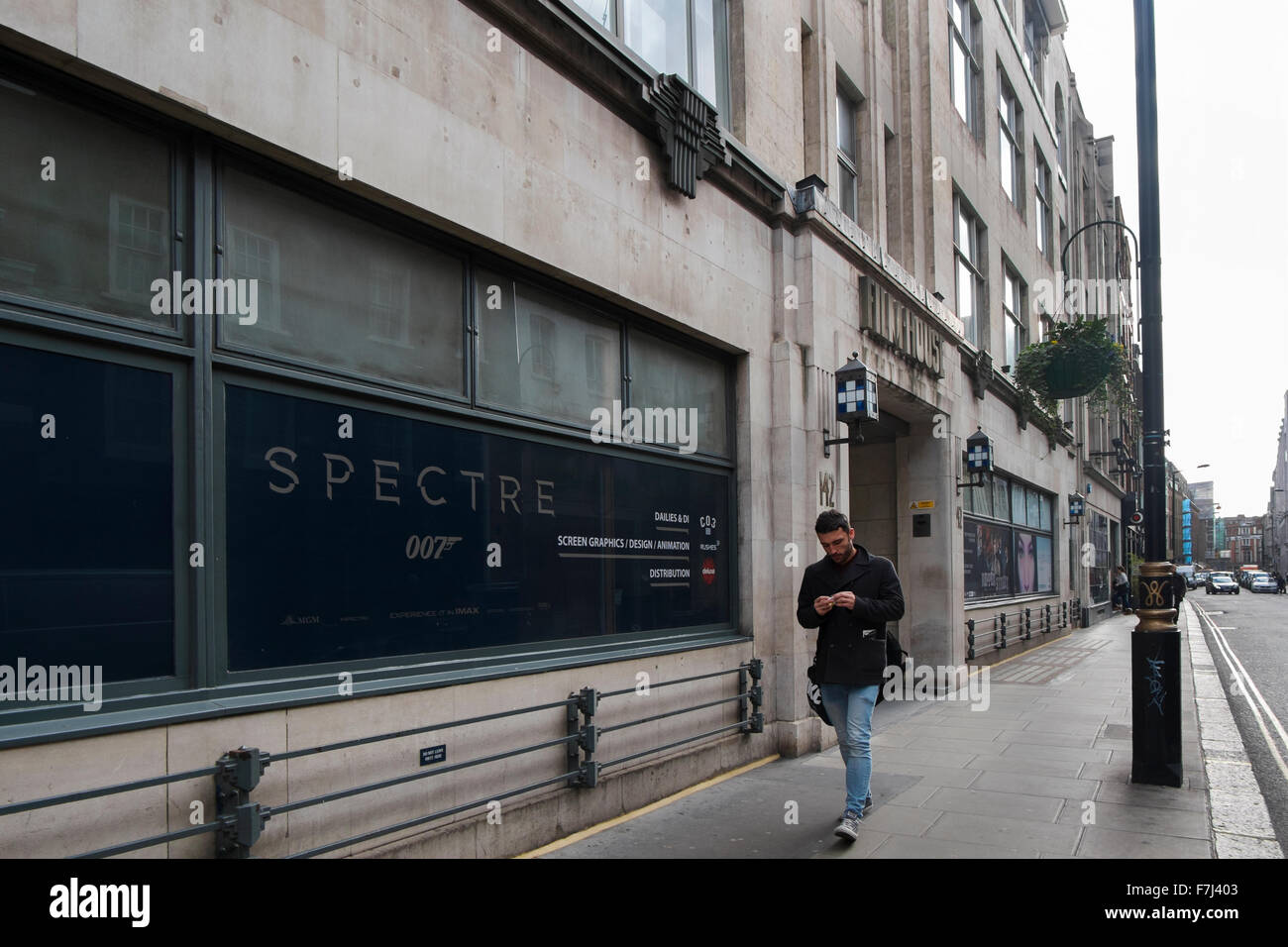 Film House with a poster for the Bond film Spectre in the window in Wardour Street, Soho, London, England, UK - Stock Image