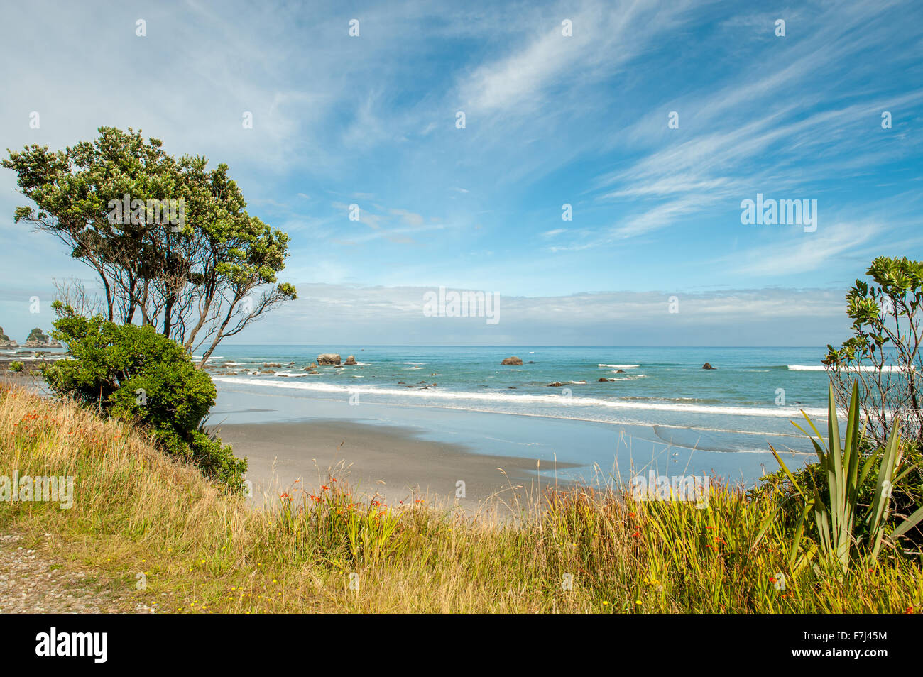 Tasman sea rolls in south of Punakaiki, South Island, New Zealand - Stock Image