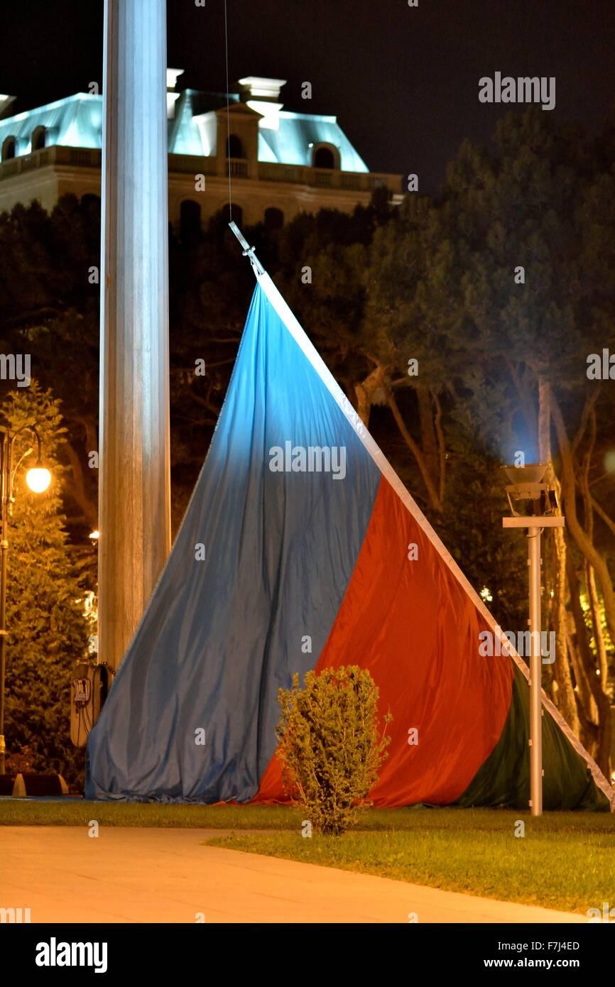 Lowering of the Azerbaijani flag at night, in Baku, capital of Azerbaijan - Stock Image