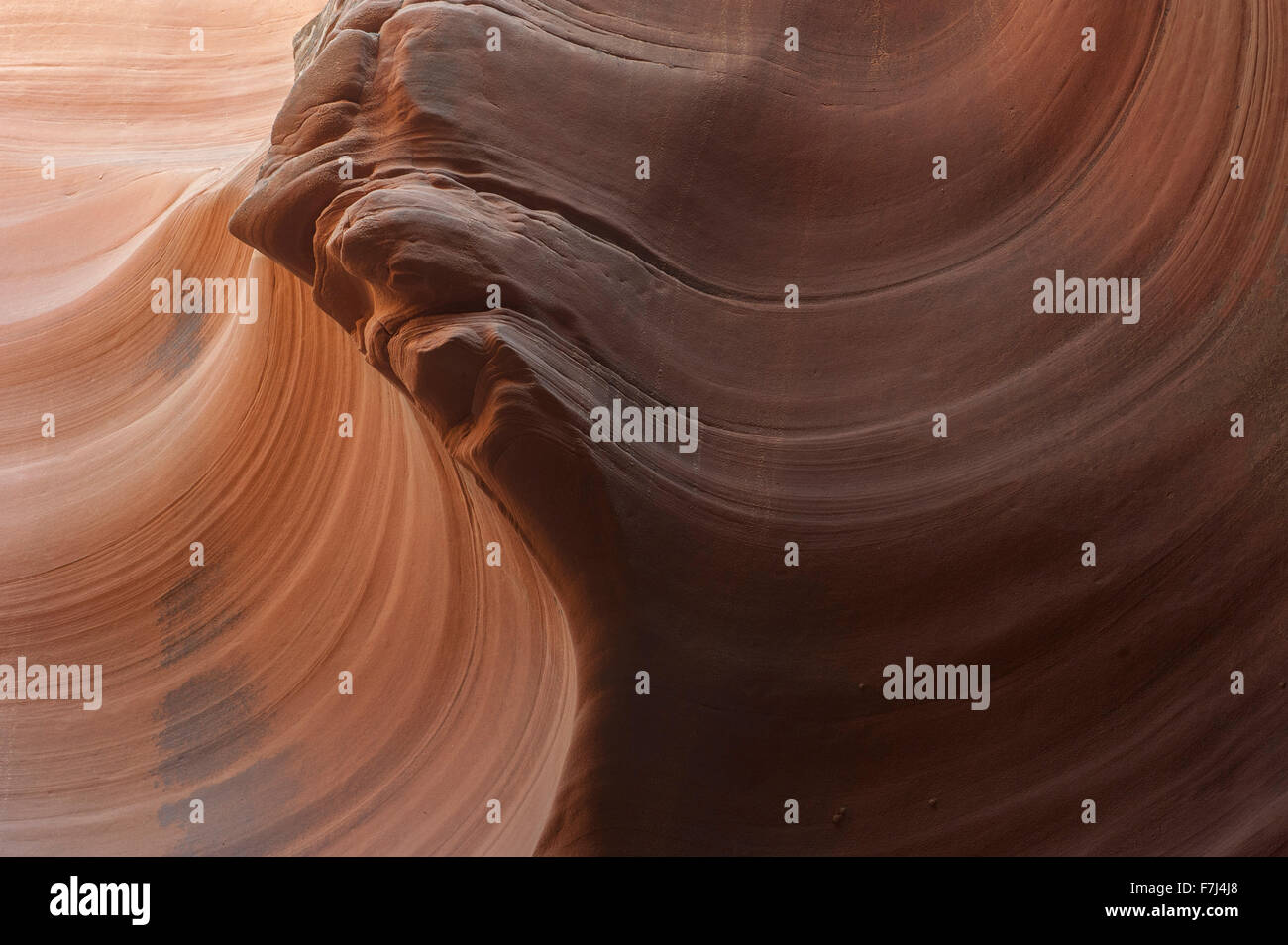 Swirled patterns on sandstone created by erosion Stock Photo