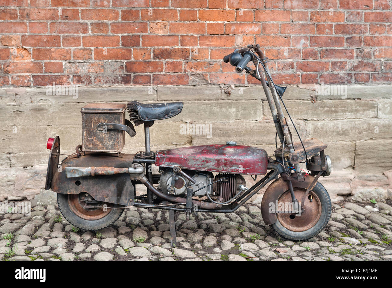 A Corgi folding motorcycle of 1948, based on the original British wartime model designed to be dropped by parachute - Stock Image