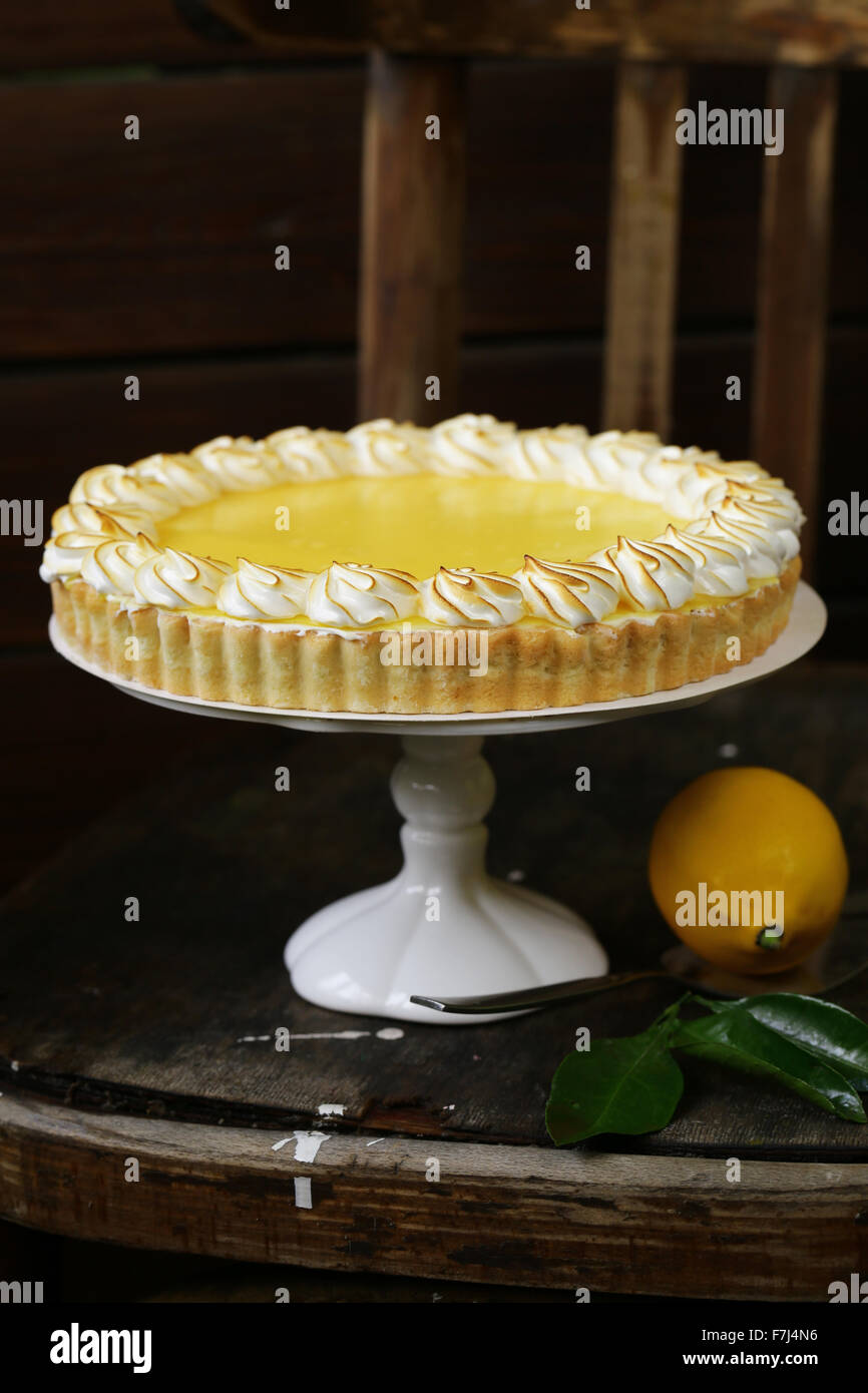 homemade baked lemon tart cake with meringue cream - Stock Image