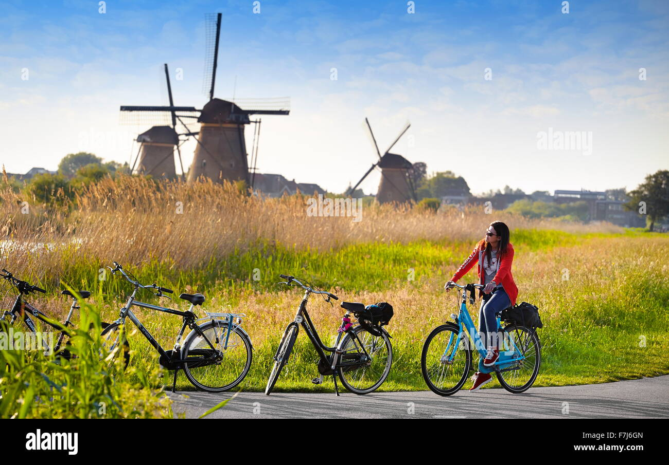Landscape view with windmills and bicycles - Kinderdijk, Holland Netherlands - Stock Image