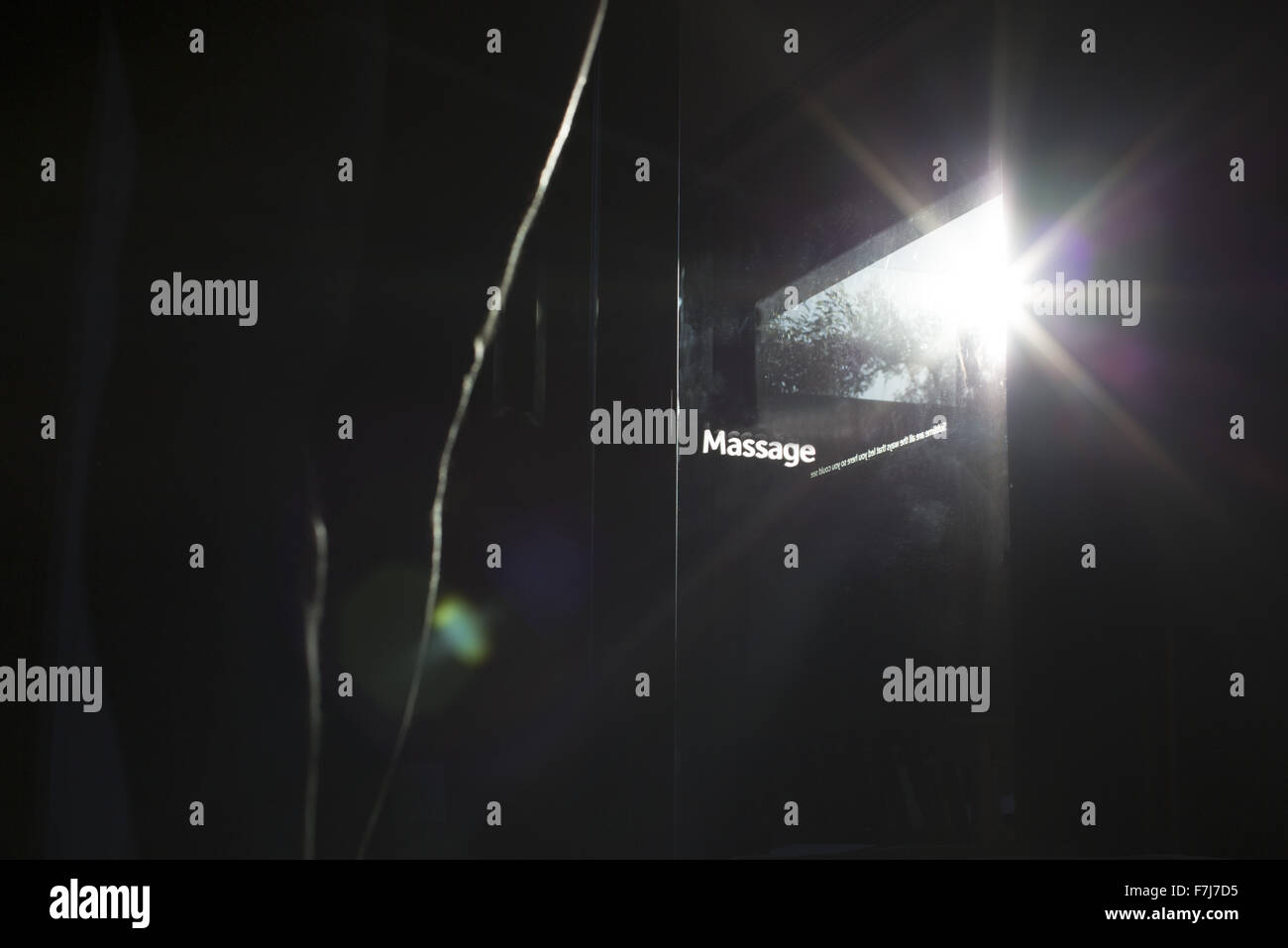 Sunlight shining through glass door in health spa - Stock Image