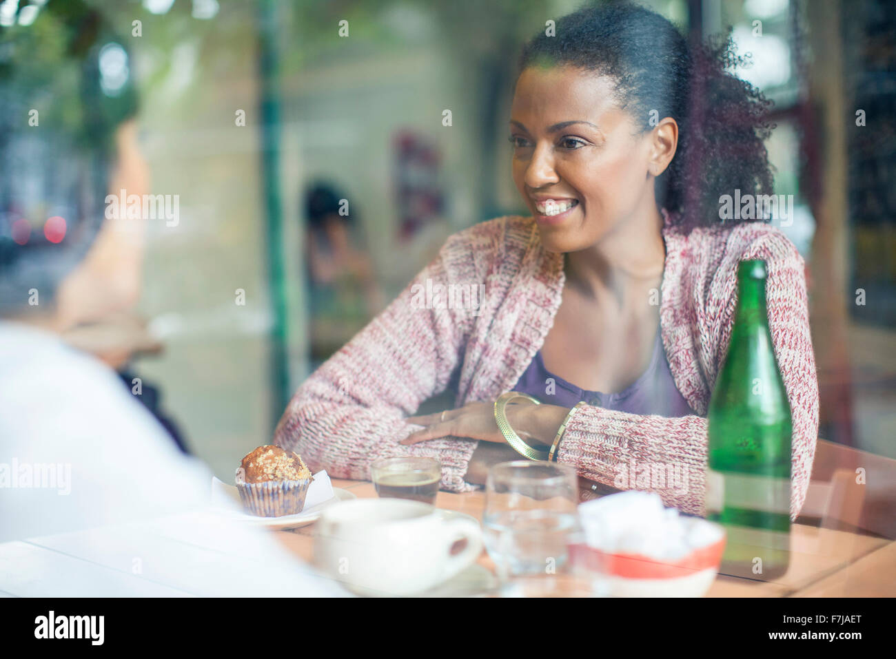 Friends meeting in coffee shop - Stock Image