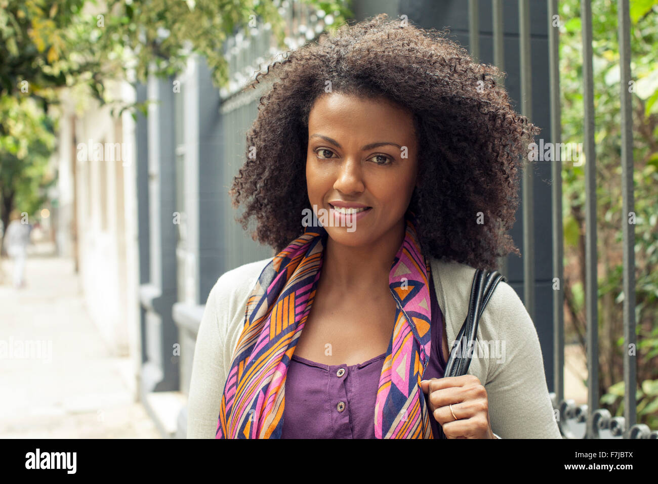 Woman with curly hair, portrait - Stock Image