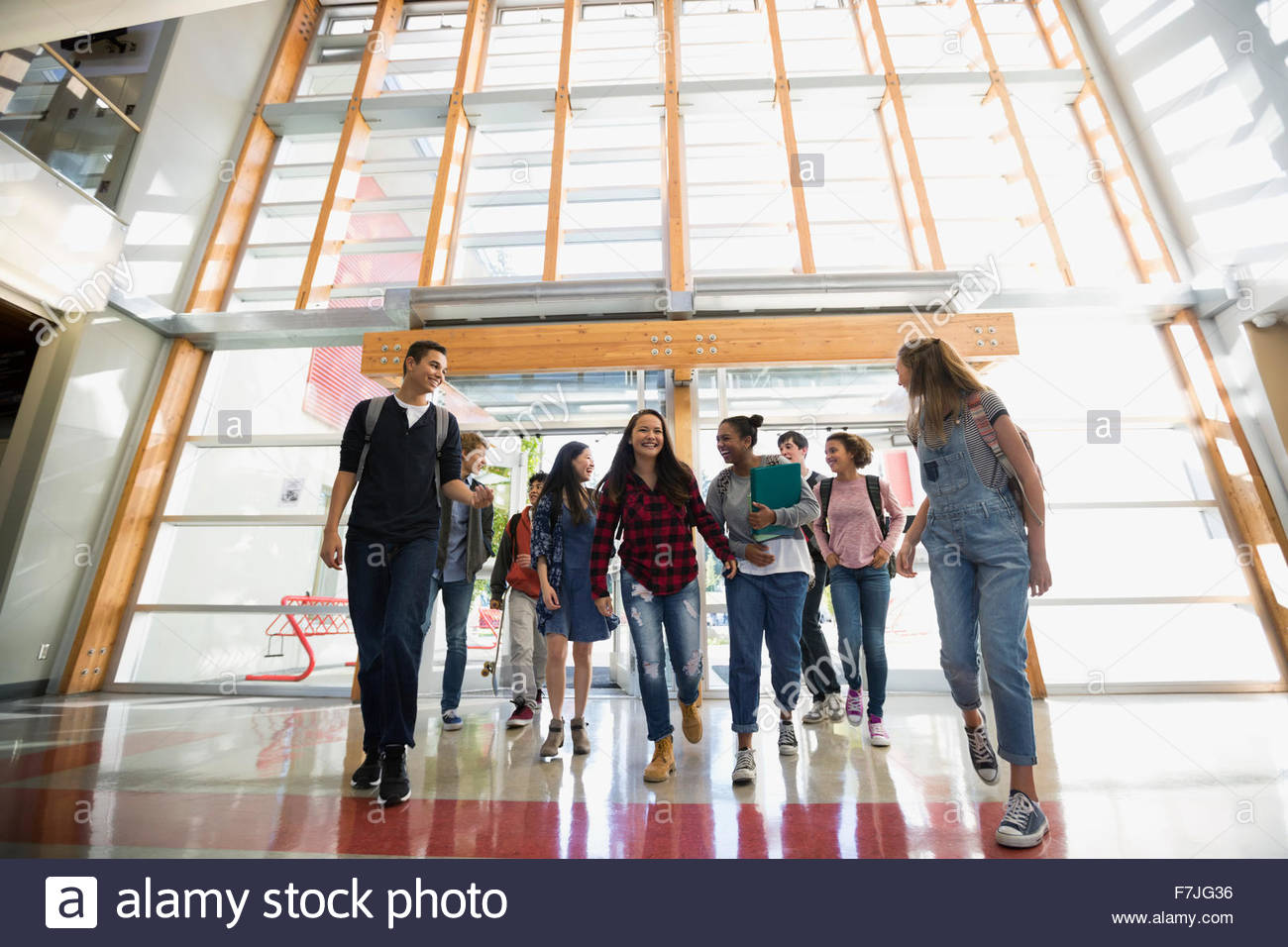 High school students entering school doors - Stock Image