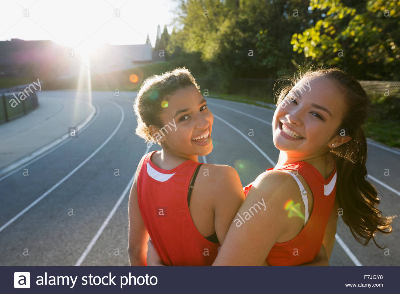 Portrait female high school track and field athletes - Stock Image