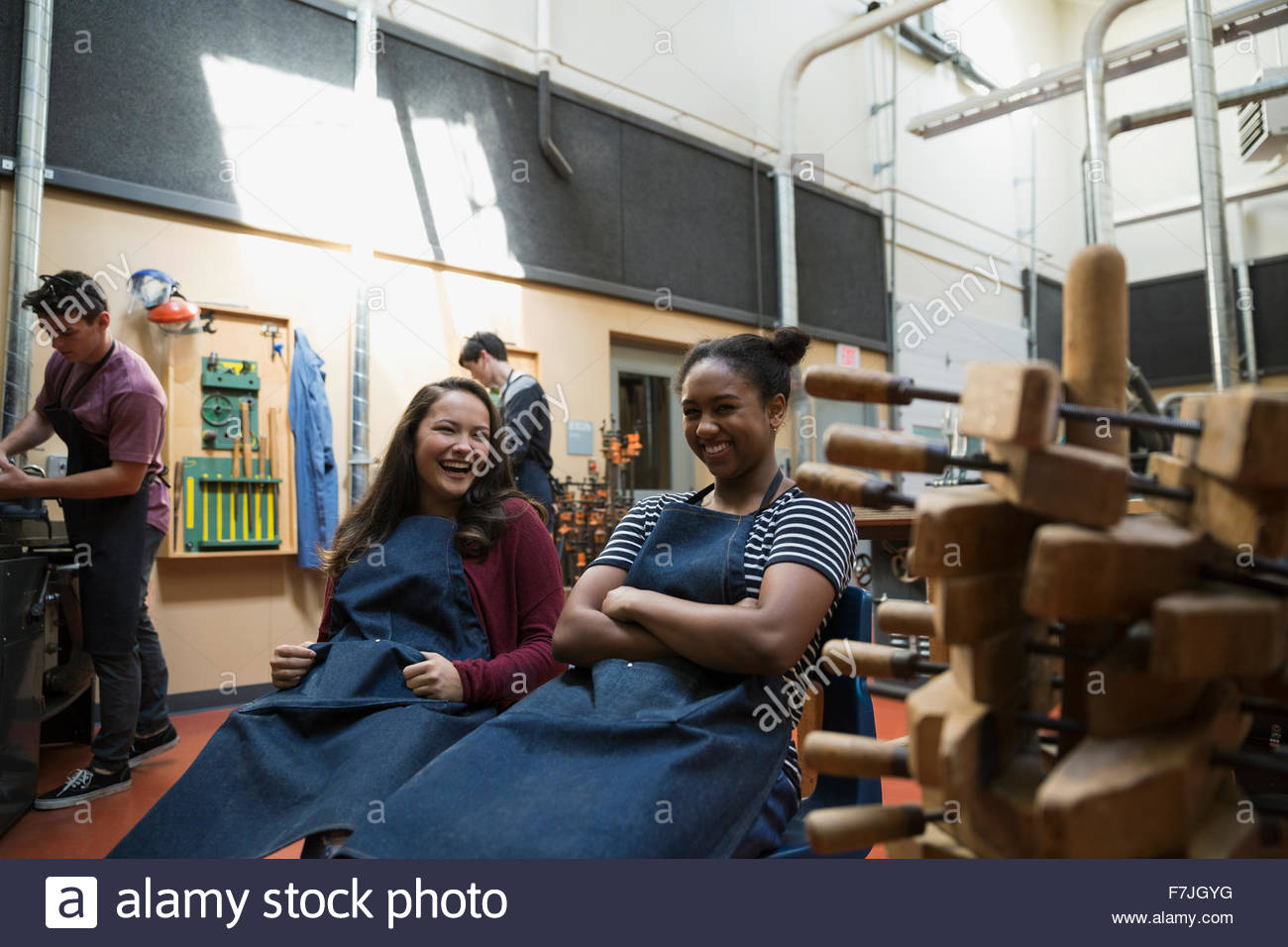 Female high school students laughing in workshop Stock Photo
