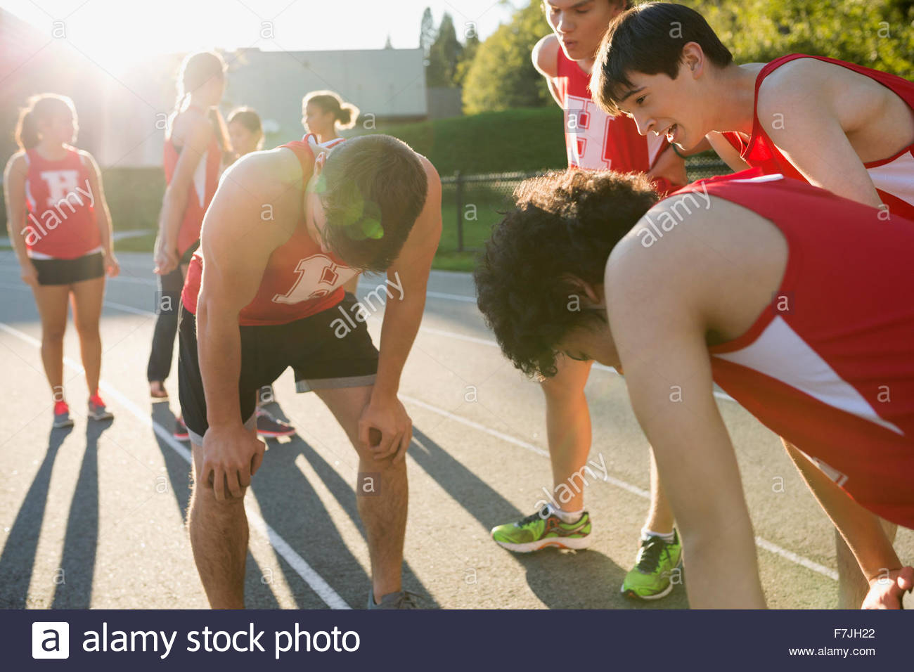 Tired high school track and field athletes - Stock Image