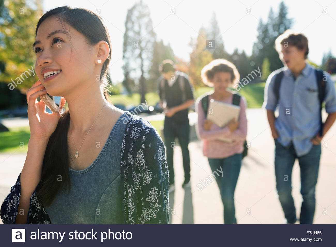 High school student talking on cell phone - Stock Image