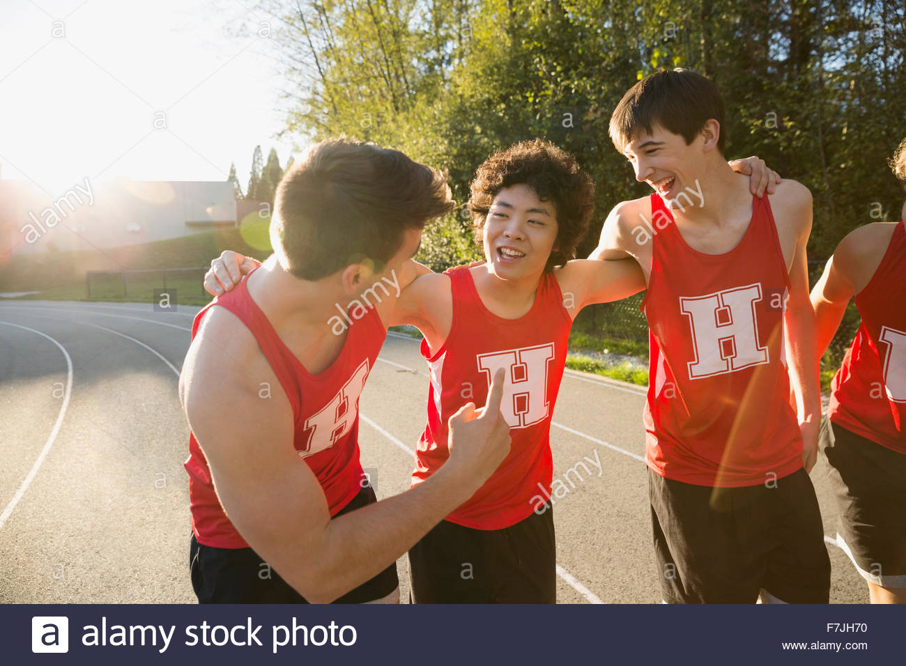 High school track and field athletes bonding - Stock Image