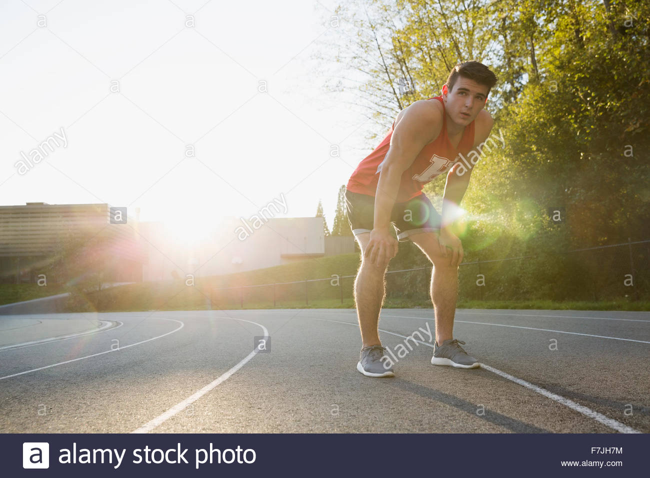 Tired high school track and field athlete - Stock Image
