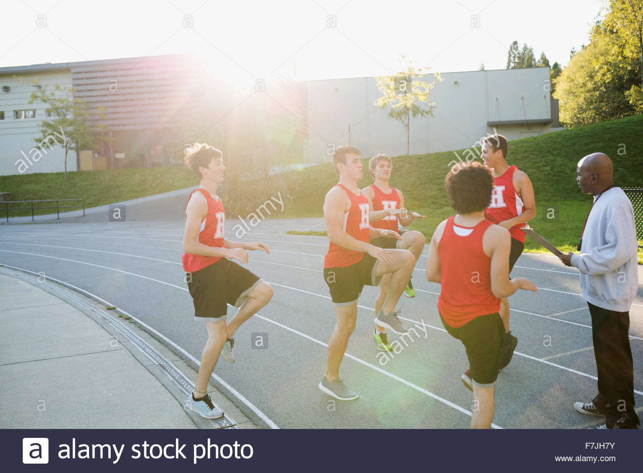 High school track and field team warming up - Stock Image