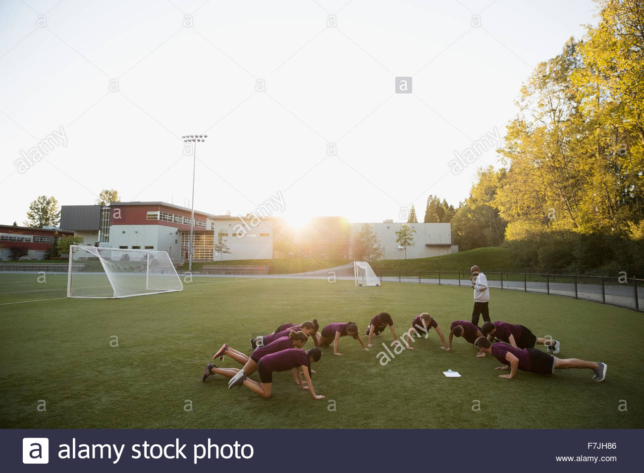 High school students doing push-ups physical education - Stock Image