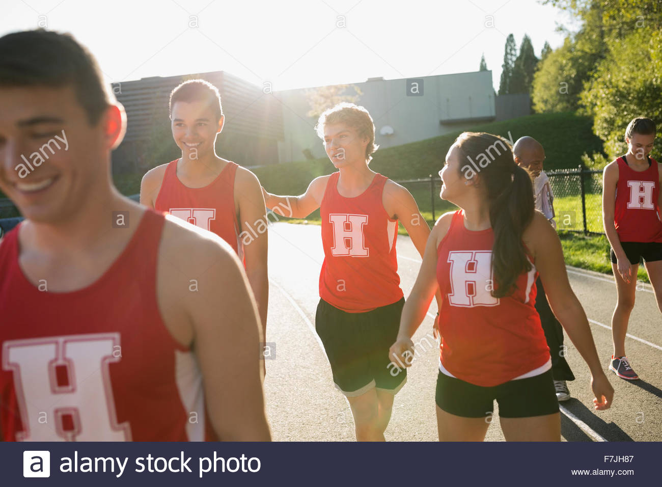 High school track and field team running track - Stock Image