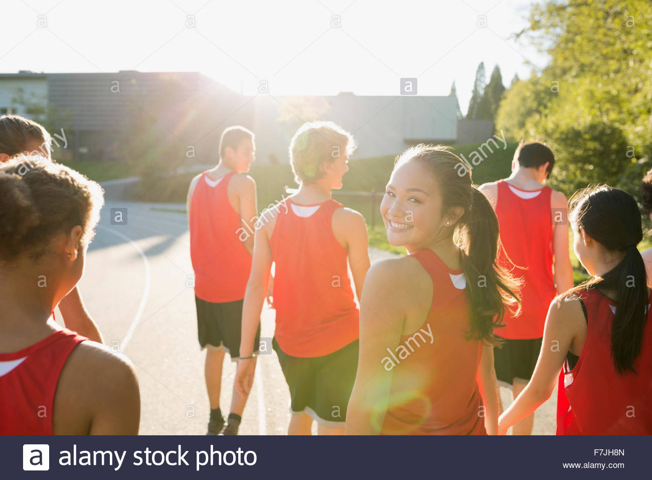 Portrait smiling high school track and field athlete - Stock Image