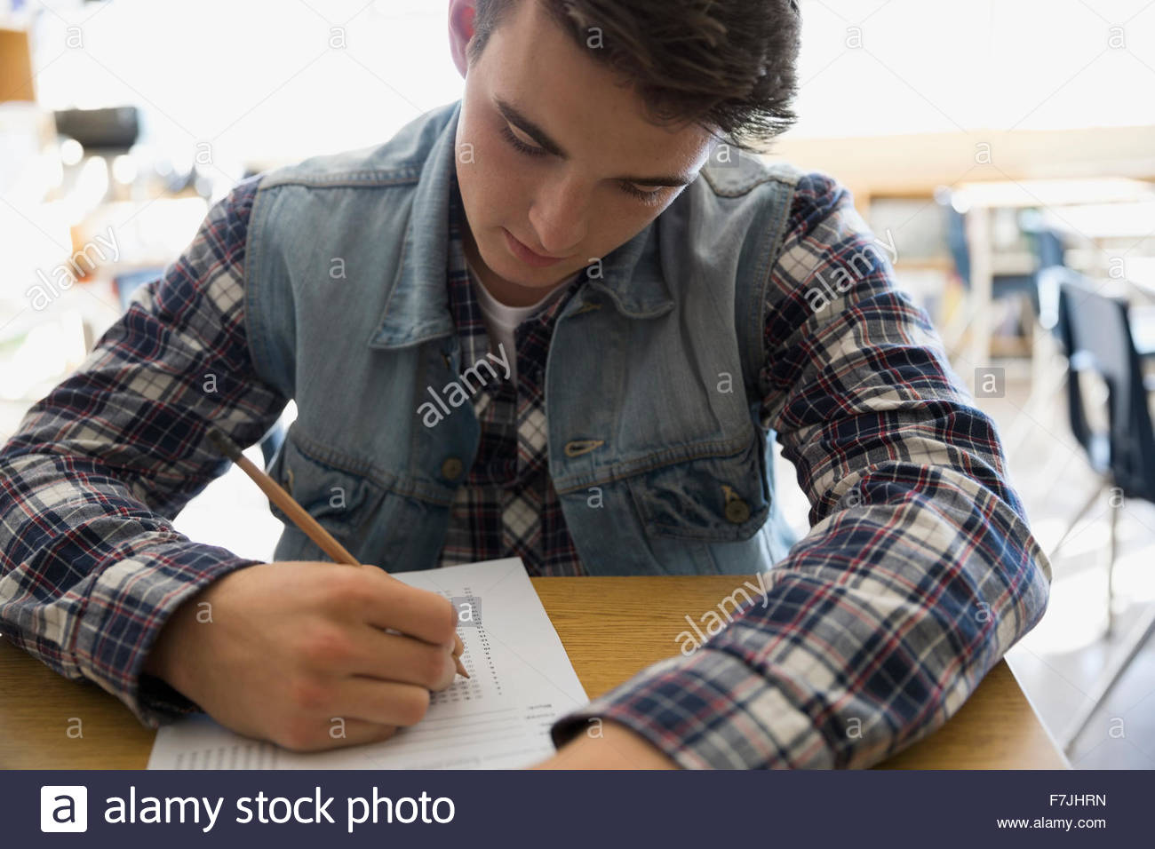 Focused high school student taking test - Stock Image