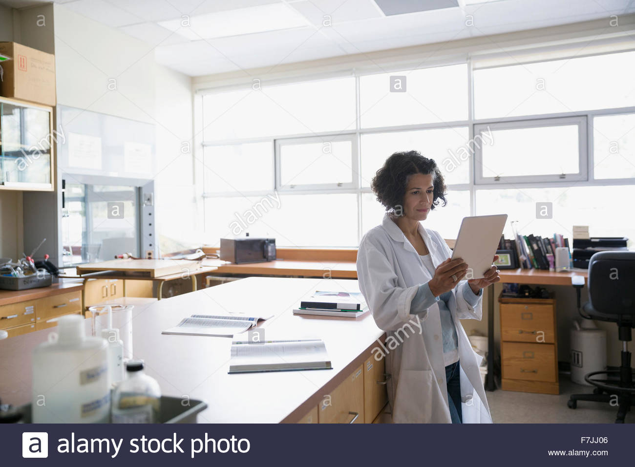 Science teacher with digital tablet in laboratory classroom - Stock Image