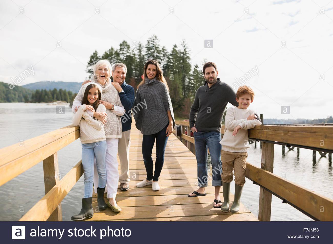 Portrait smiling multi-generation family on lake dock - Stock Image